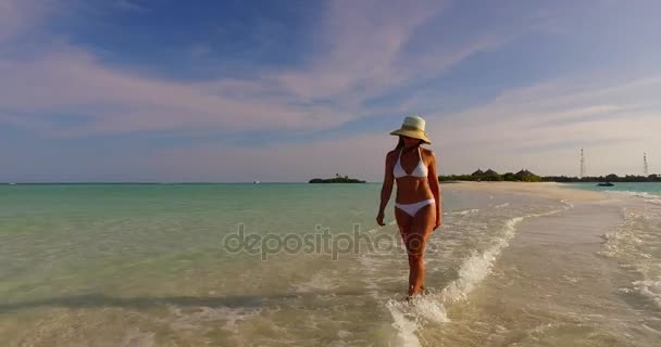 v07846 Maldives white sandy beach 1 person young beautiful lady sunbathing alone on sandbar on sunny tropical paradise island with aqua blue sky sea water ocean 4k