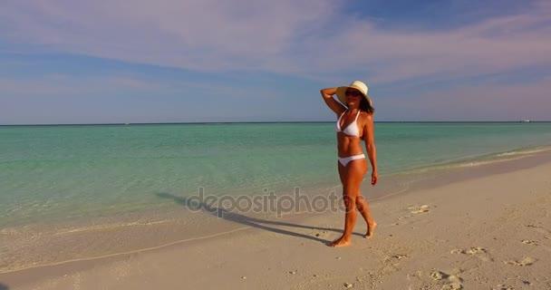 v07947 Maldives white sandy beach 1 person young beautiful lady sunbathing alone on sandbar on sunny tropical paradise island with aqua blue sky sea water ocean 4k