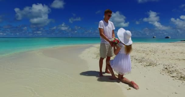 v07383 Maldives white sandy beach 2 people young couple man woman proposal engagement wedding marriage on sunny tropical paradise island with aqua blue sky sea water ocean 4k