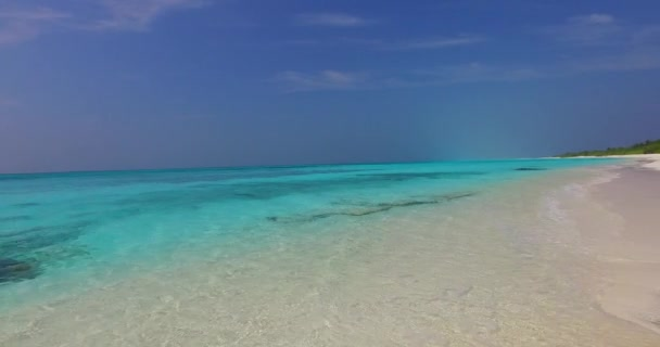 v07731 Maldives beautiful white sandy beach background on sunny tropical paradise island with aqua blue sky sea water ocean 4k