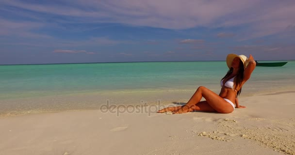 v07857 Maldives white sandy beach 1 person young beautiful lady sunbathing alone on sandbar on sunny tropical paradise island with aqua blue sky sea water ocean 4k