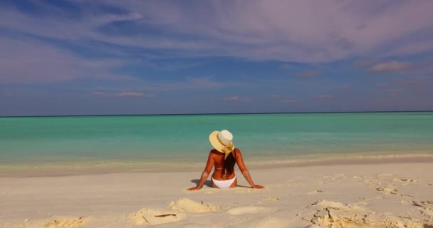 v07916 Maldives white sandy beach 1 person young beautiful lady sunbathing alone on sandbar on sunny tropical paradise island with aqua blue sky sea water ocean 4k