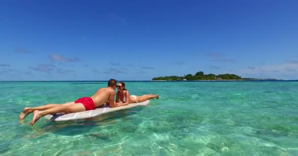 v11354 two 2 people romantic young people couple paddleboard surfboard with drone aerial flying view on a tropical island of white sand beach and blue sky and sea