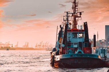 Hamburg, Germany - November 01, 2015: Tug boat at the quai of harbor Hamburg waits for the next tug job in the evenning.