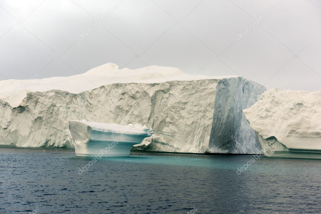 huge icebergs are on the arctic ocean in Greenland
