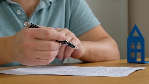 Real estate broker and customer signing a contract: real estate, home loan concept. Close up