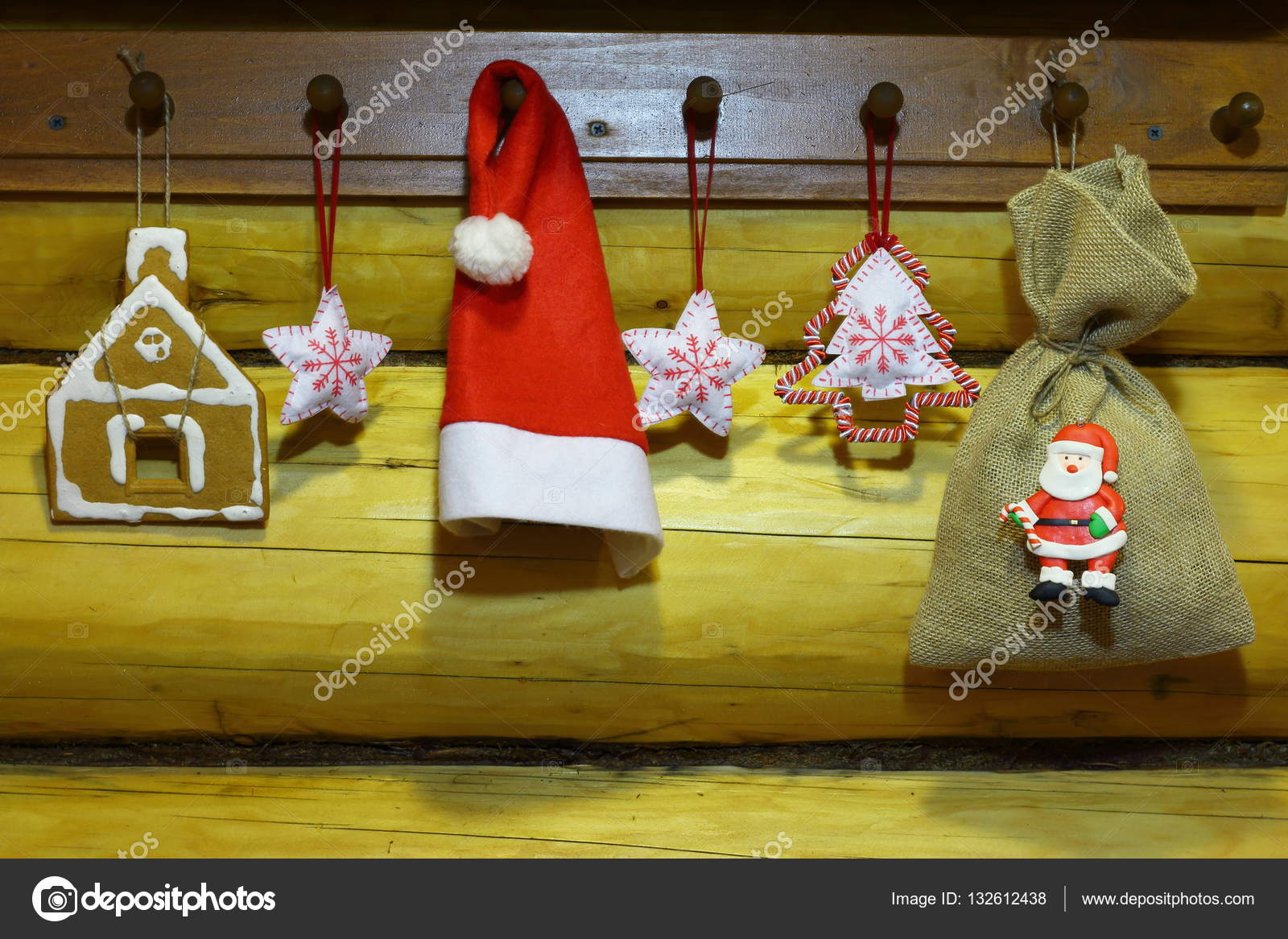 Christmas and new year decorations weigh on a wooden hanger on the ...