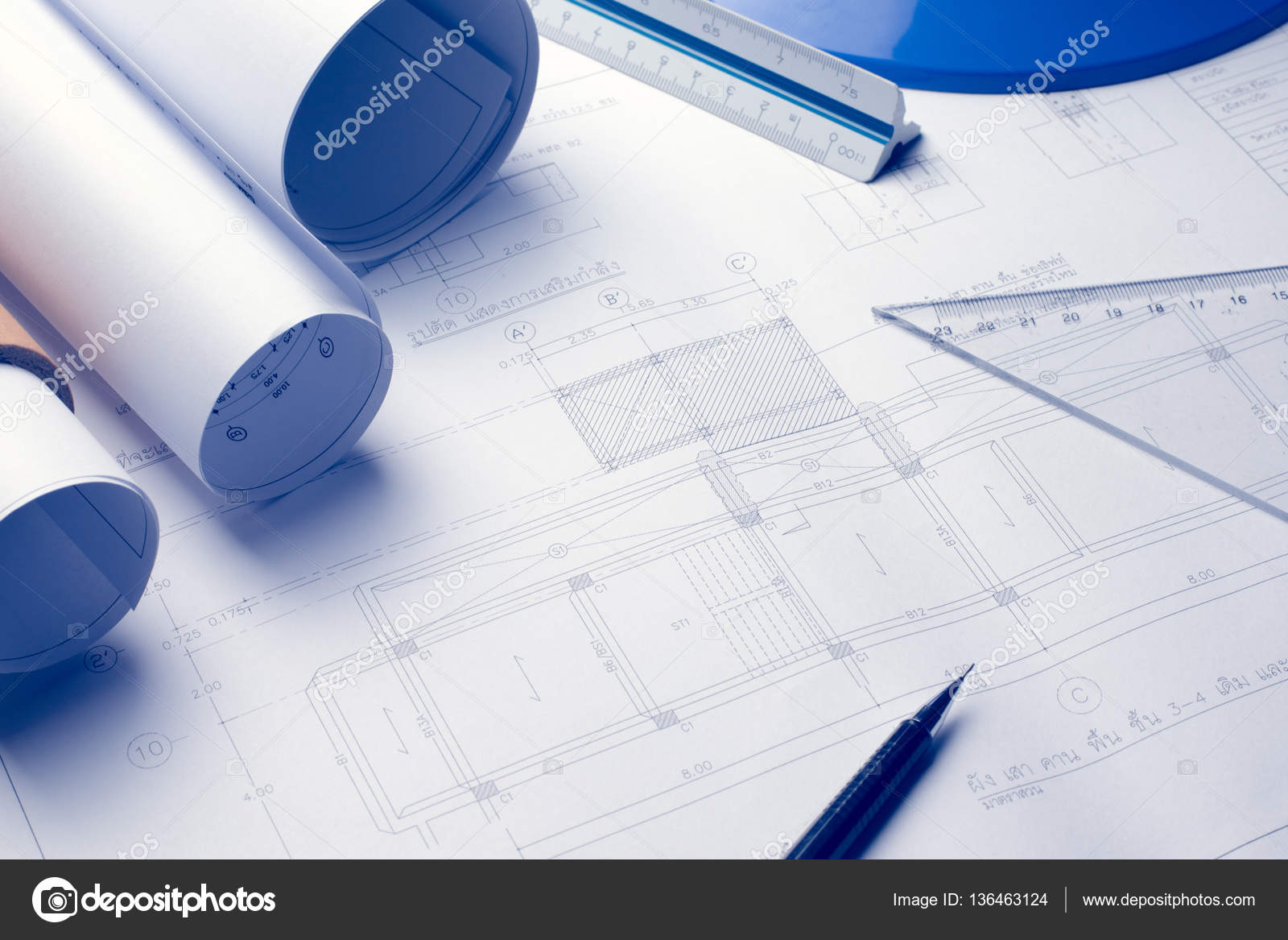 Architectural blueprints and blueprint rolls and a drawing instr architectural blueprints and blueprint rolls and a drawing instr stock photo malvernweather Gallery