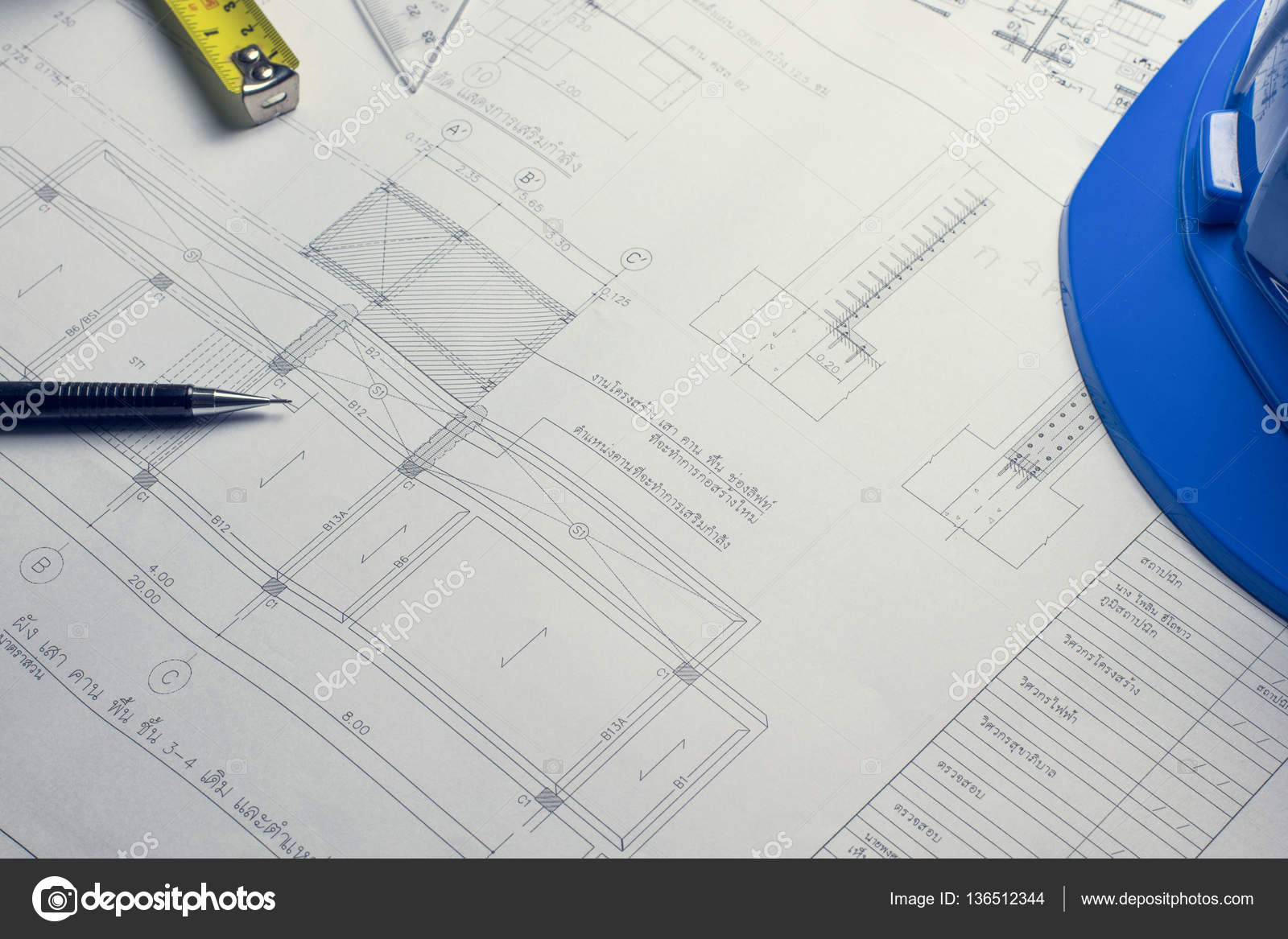 Architectural blueprints and blueprint rolls and a drawing instr ...