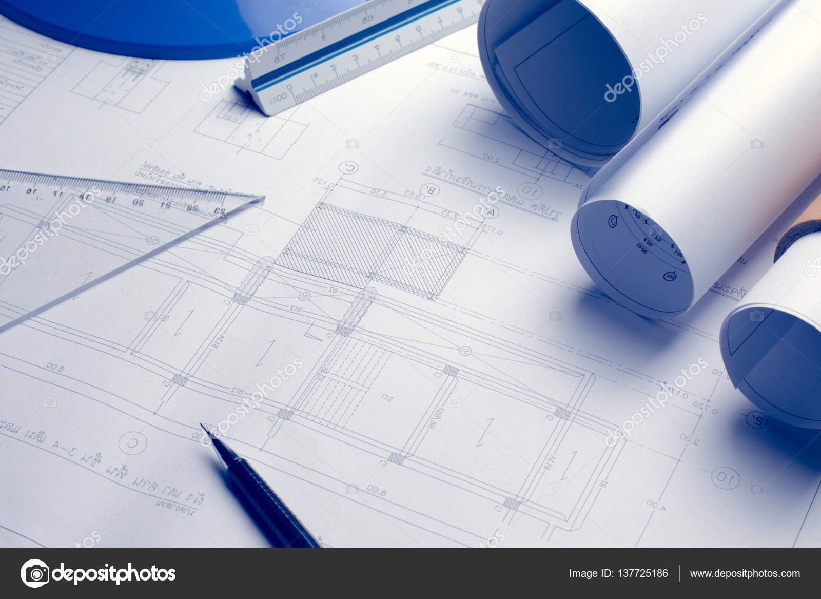Architectural blueprints and blueprint rolls and a drawing instr architectural blueprints and blueprint rolls and a drawing instr stock photo malvernweather Image collections