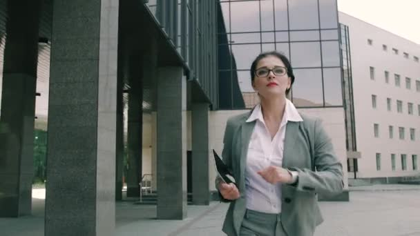 Young attractive business woman being late for the meeting