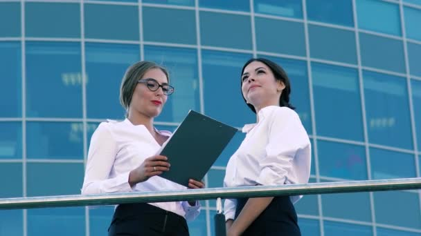 Portrait of young business women talking about their business