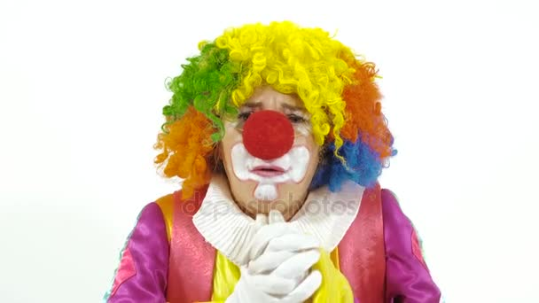 funny clown making faces on white