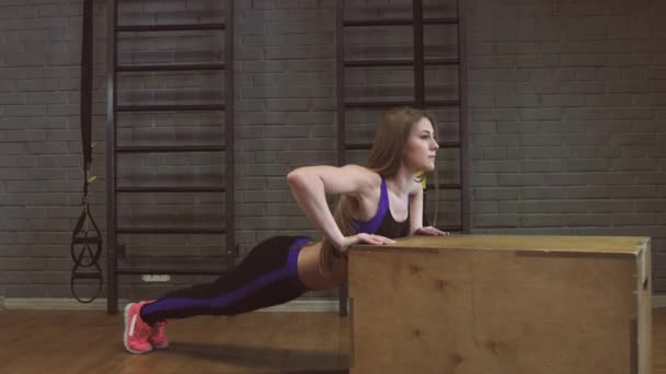Gym woman push-up strength pushup in a fitness workout