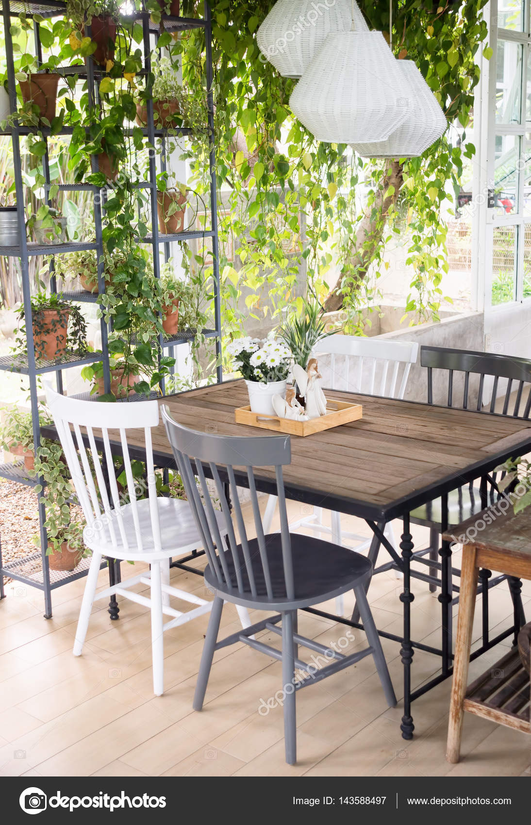 Dining Room Interior With Table Chairs And Plants Against Big W Stock Photo C Scorpionce 143588497