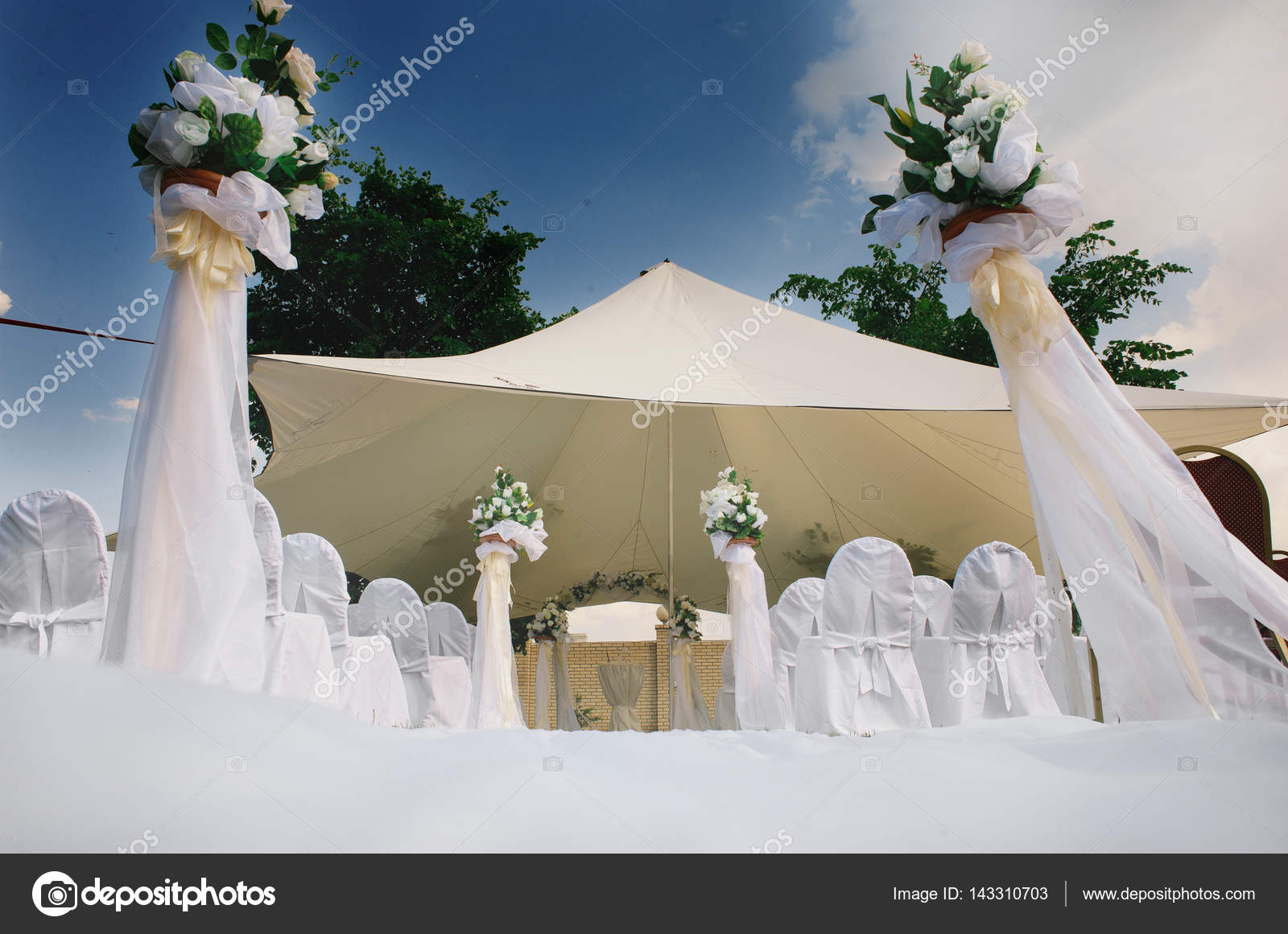 White wedding canopy in summer with white fabric chairs decoration of flowers white roses & white wedding canopy in summer with white fabric chairs ...