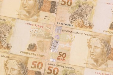 Brazilian money background. Bills called Real. Economy of Brazil