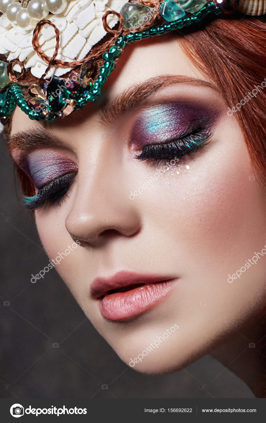 780ffd54420 Redhead girl with bright makeup and big lashes. Mysterious fairy woman with red  hair.