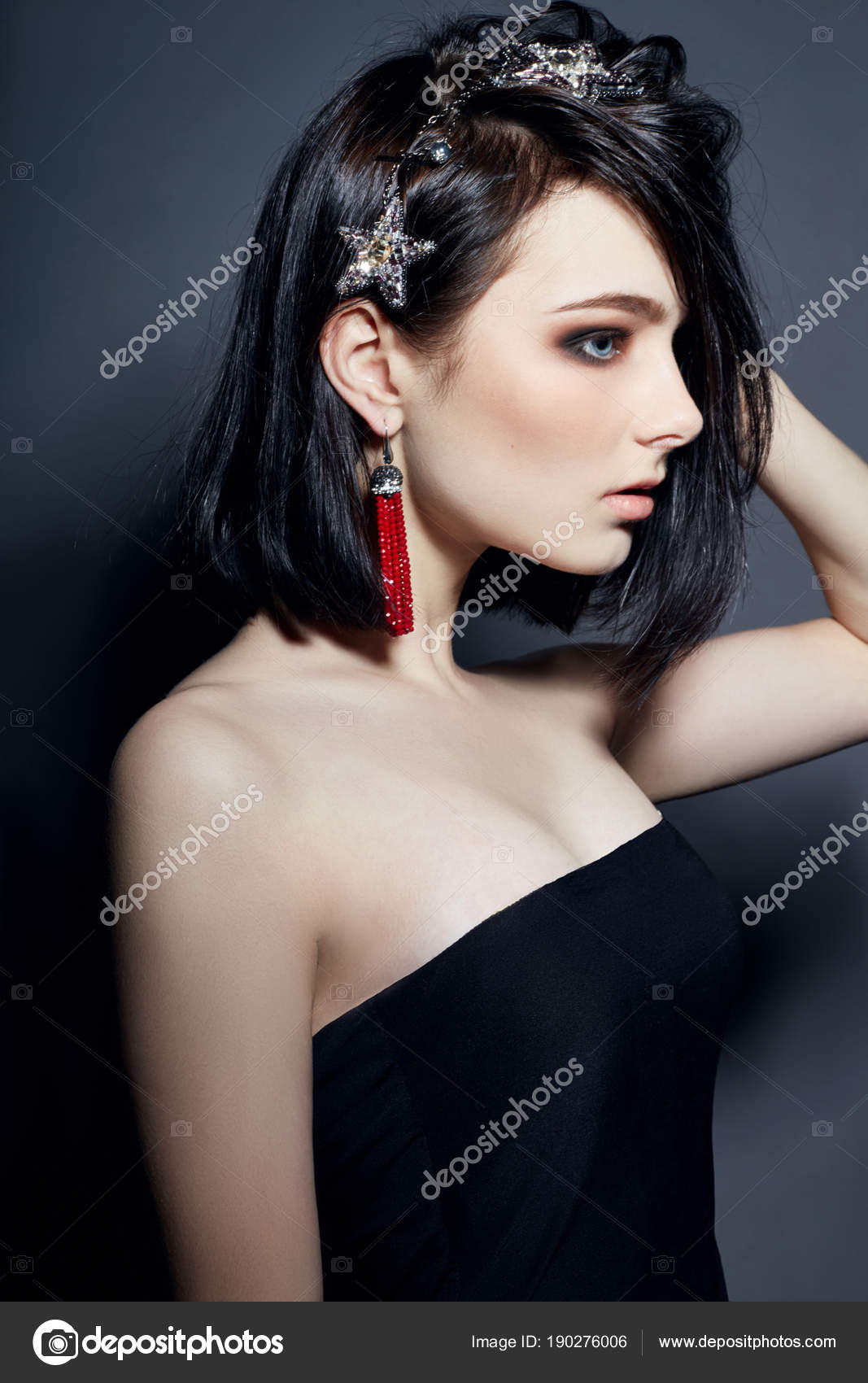 Beautiful Brunette Girl With Big Blue Eyes Earrings And Necklace
