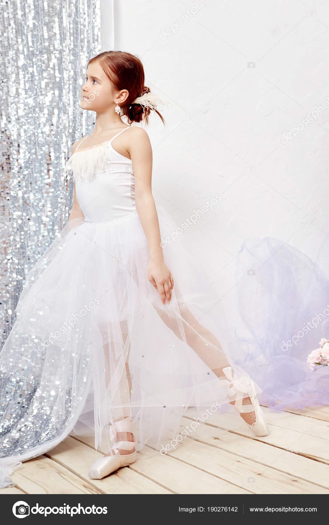 prima ballet. Young ballerina girl is preparing for a ballet ...