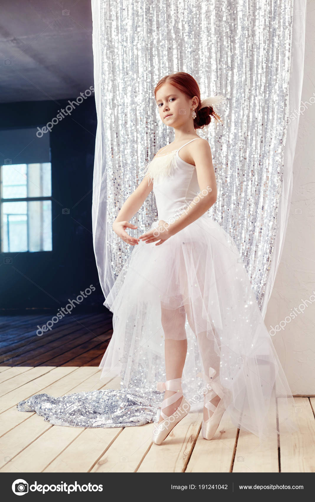 Little prima ballet. Young ballerina girl is preparing for a bal ...