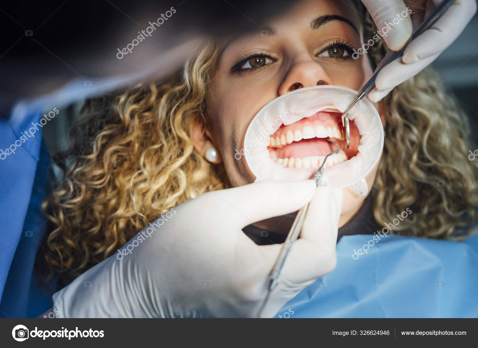 Dentist working in his office with a patient.