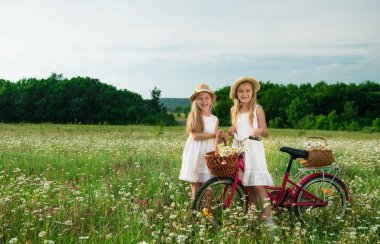 Girls staying near bicycle