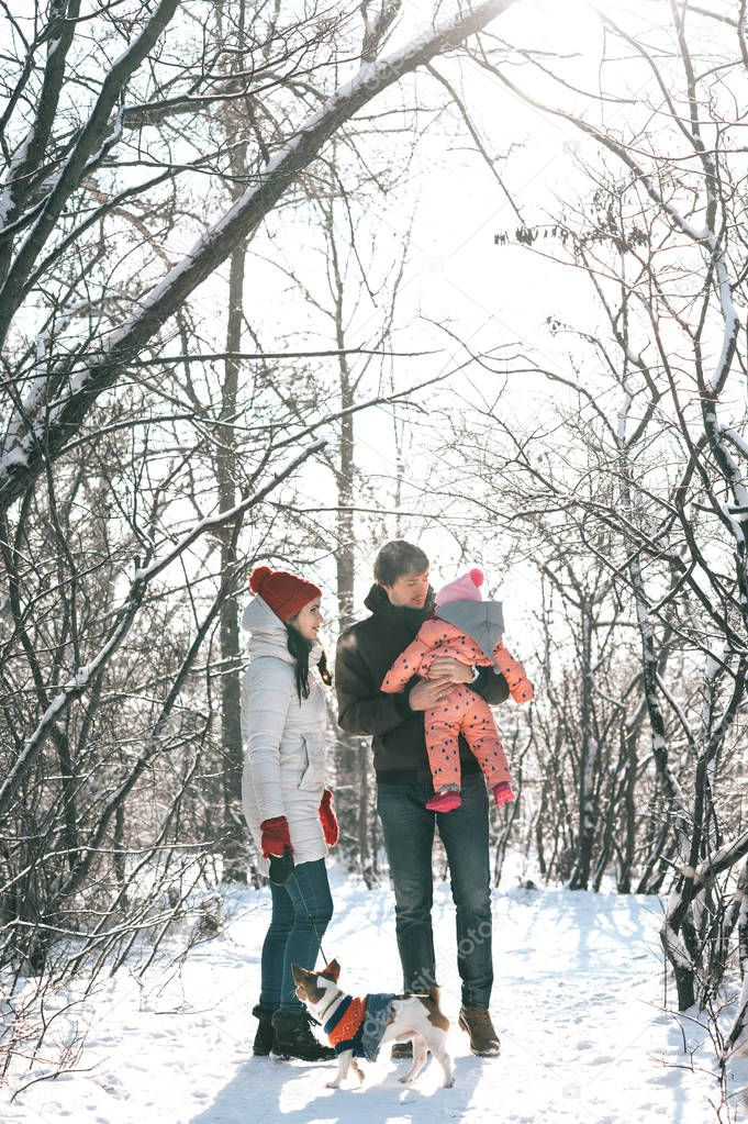 Young family in a winter park