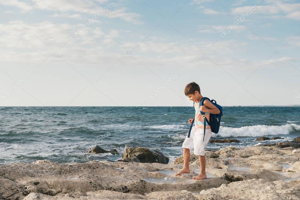 Little boy on a rock