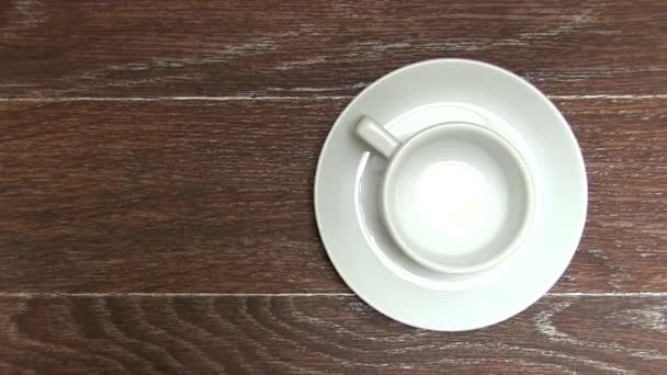 Empty White Coffee Cup with Saucer On Brown Table