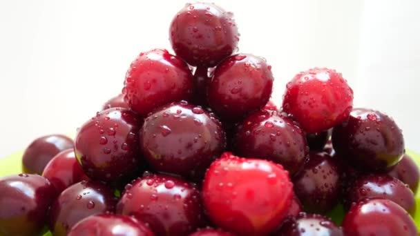 Rotating of Pile Wet Ripe Sweet Cherries