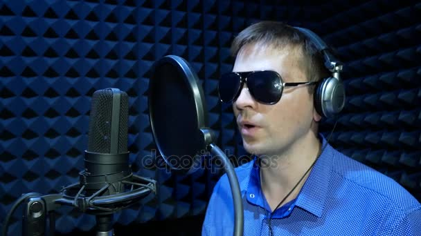 Blind Man in Black Glasses Reads Braille and Recording a Voice in the Sound Recording Studio