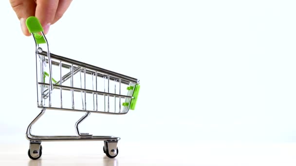 The hand controls shopping cart or market basket isoleted on white background. Concept of online store