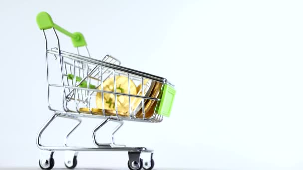Shopping cart or market basket with cryptocurrency bitcoins isoleted on white background. Concept of online store