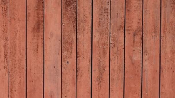 Red old painted wooden surface for background texture