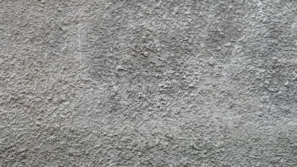 Old and torn surface of gray cement wall