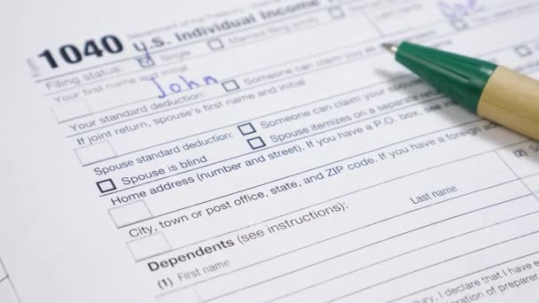 Male Hand Filling 1040 Tax Form