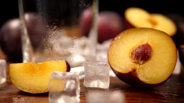Cut Slice Ripe Plum on Wooden Surface with Ice