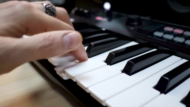 Composer Plays on Musical Synthesizer