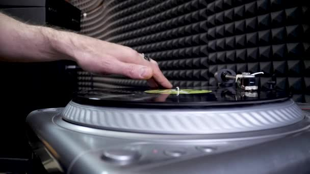 Djs Hand Mixing and Scratching Vinyl Disc in Professional Record Studio