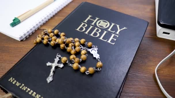 Rosary beads with cross crucifix on Holy Bible