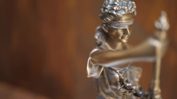 Bronze Statue of Themis or Lady of Justice on Brown Background