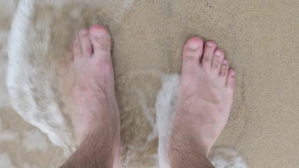 Male Barefoot in Foaming Sea Water Waves