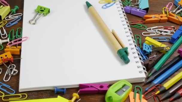 School paper notebook and various stationery on brown wooden table