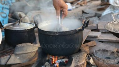 Traditional cooking by fire at the country of Thailand