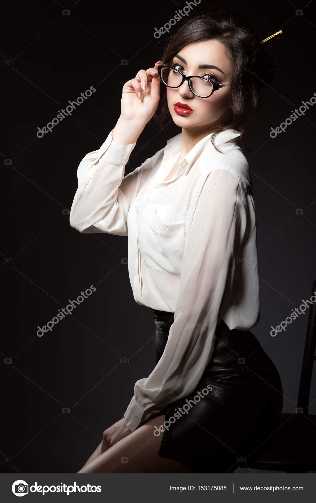 4be6d8db6d5c9c Beautiful young sexy business woman with dark updo hair and red lips  wearing white silk blouse and black short leather skirt looking direct over  her trendy ...