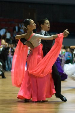 DNIPROPETROVSK, UKRAINE - SEPTEMBER 24: An unidentified dance couple in a dance pose during World Dance Competition DNEPR CUP 2011 on September 24, 2011 in Dnipropetrovsk, Ukraine.