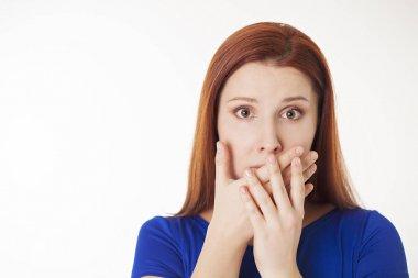 Woman shutting her mouth