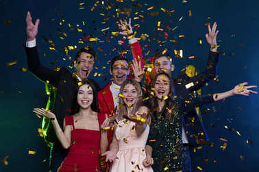 Cool party. Happy and smiling friends at party with confetti.  People and holidays concept. Celebration and party. New year. Birthday