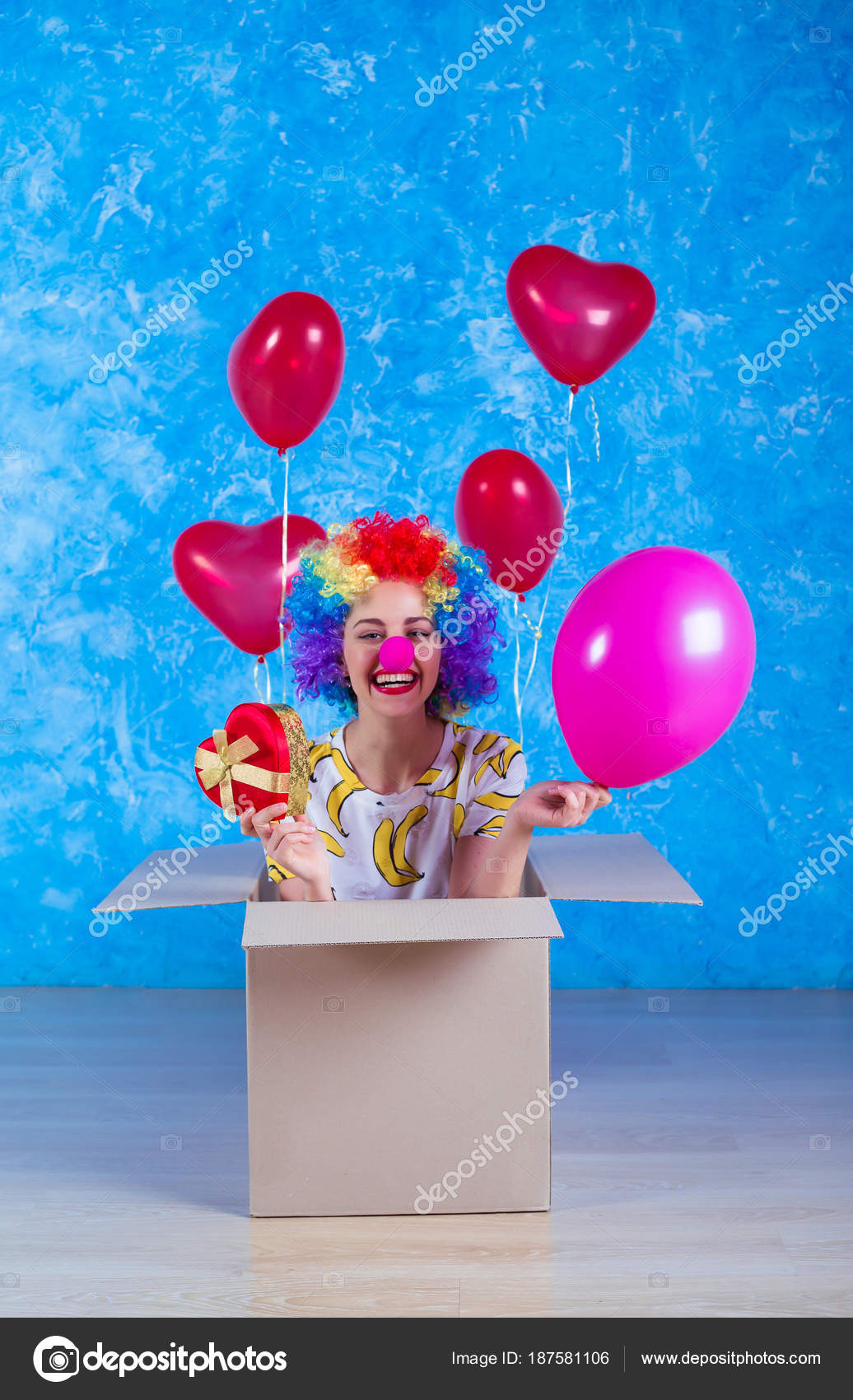 april fools day concept funny clown sits cardboard box helium